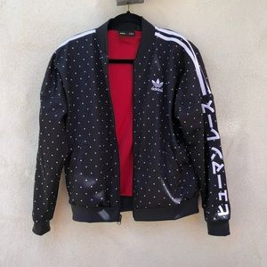 Never worn adidas jacket by Pharrell Williams